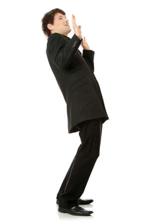 Scared young businessman, isolated on white photo