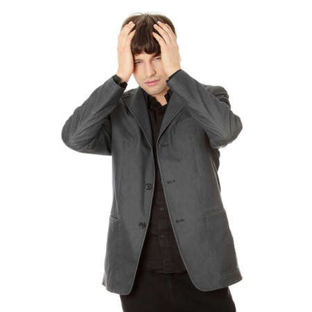 Young businessman with a big headache or problem, isolated on white Stock Photo - 8830593