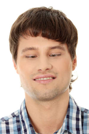 squint: Young man making squint, isolated on white