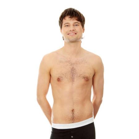 desnudo masculino: Apuesto joven feliz en ropa interior. Aislados en blanco
