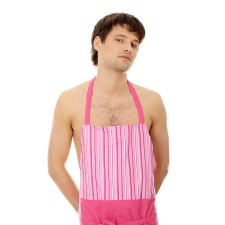 Naked man wering pink apron. Isolated on white. Stock Photo - 8829932