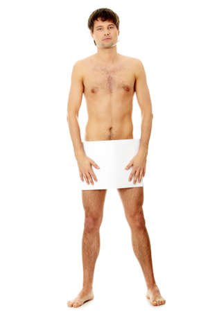 nude man: Young handsome nude man covering his self with a copy space blank billboard isolated on white