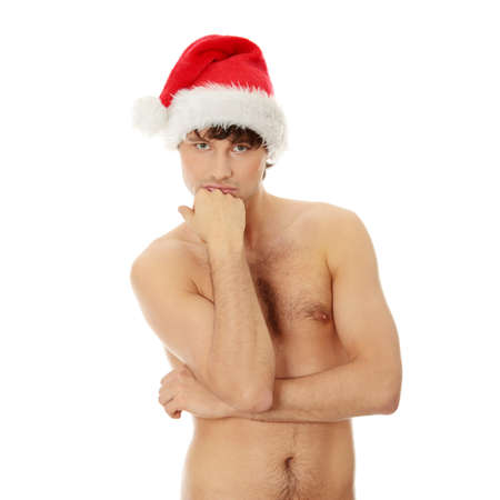 Young handsome man with Santa's cap standing naked. Isolated on white in studio.  Stock Photo - 8827977