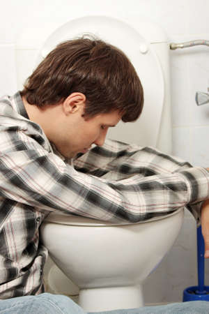 nausea: Young man (drunk or sick) vomiting Stock Photo