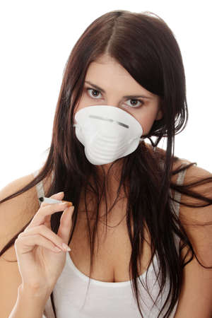 Young smoking woman with face mask, isolated  photo