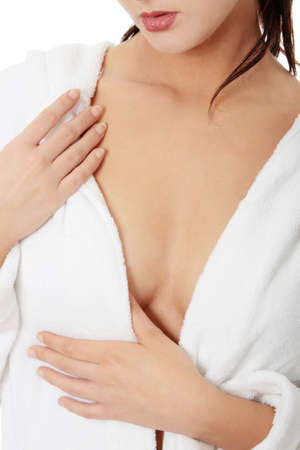 breast examination: Breast care concept - woman in bathrobe