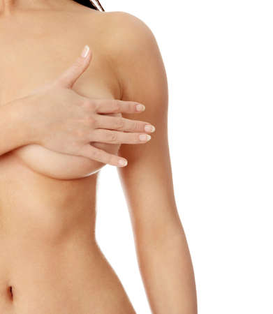 naked breasts: Topless woman body covering her breast with hand, isoalted on white. Breast cancer concept