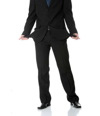 Sad and broke business man with empty pockets , isolated on white photo
