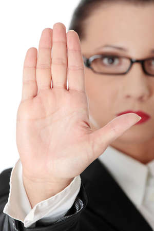 Hold on, Stop gesture showed by businesswoman hand Stock Photo - 8829078