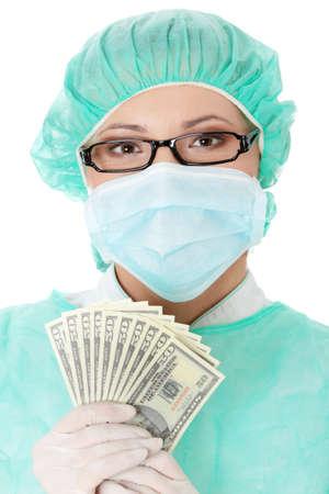 Female surgeon doctor holding money , isolated on white background Stock Photo - 8830009