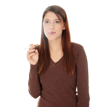 Young woman smoking electronic cigarette (ecigarette), isolated on white photo