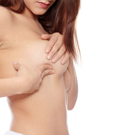 Young Caucasian adult woman examining her breast for lumps or signs of breast cancer Stock Photo - 8830492