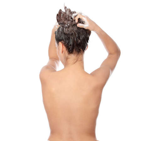 woman in shower: Beautiful young brunette woman soaping her head - isolated on white background  Stock Photo