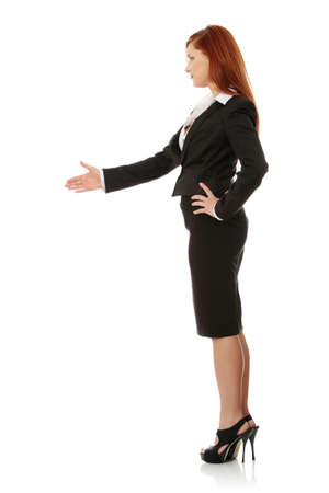 Business woman extend hand over white background  Stock Photo