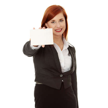 Beautiful smiling business woman holding a blank card over a white background - focus on card photo