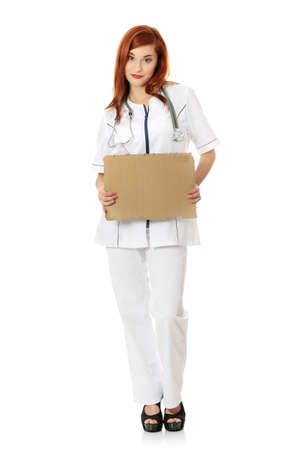 Unemployed female doctor with empty cardboard sign , isolated on white background  photo