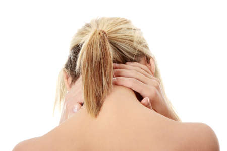 Woman massaging pain in her neck, isolated on white Stock Photo - 8959305