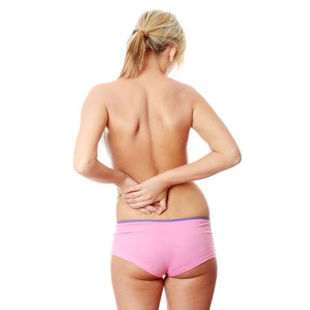 femme se deshabille: Femme masser la douleur dans son dos, isol� sur fond blanc