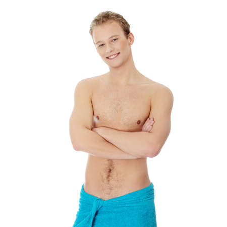 Handsome, young, naked man with the towel around his waist. Isolated on white Stock Photo - 8958124