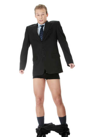 falling down: Young businessman caught with pants down. Isolated on white background.  Stock Photo