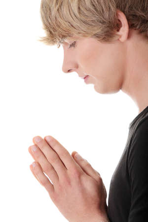 worship white: Young man with palms together, praying. Isolated on white background.