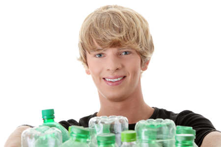 Young man carrying a plastic container full with empty recyclable household material. Stock Photo - 8958837