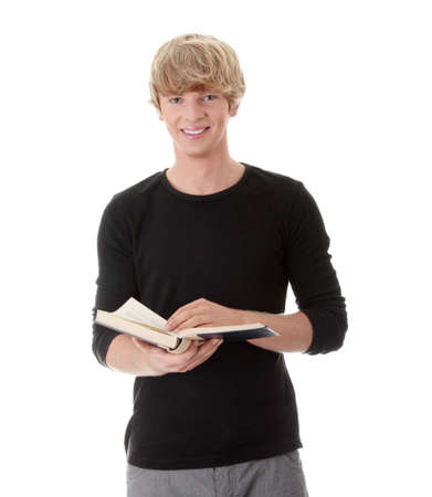 Teen man reading book , isolated on white background photo
