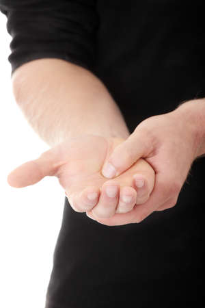 unhealth: Man holding his hand - pain concept