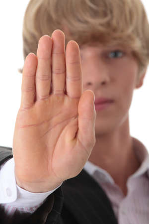 Hold on, Stop gesture showed by businessman hand  photo