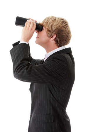 Business Vision concept - young man with binoculars isolated on white photo