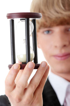 Businessman showing how to save time photo
