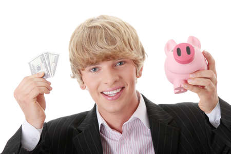 Young business holding piggy bank and dollars photo