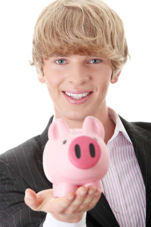 Young business holding piggy bank  photo