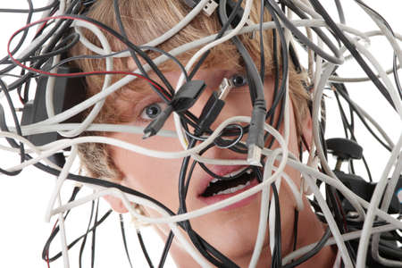 Businessman wrapped in computer cables photo