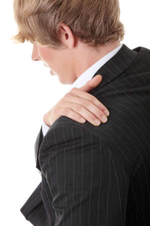 Businessman holding his hand to his aching back  photo