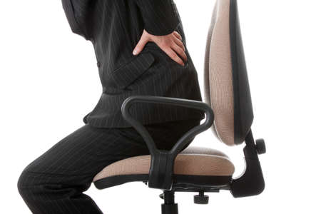 spinal disks: Businessman holding his hand to his aching back