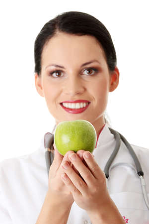 Healthy eating or lifestyle concept. Smiling woman doctor with a green apple. Stock Photo - 8957692