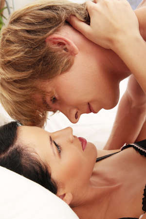 Young caucasian couple in bed Stock Photo - 8972730