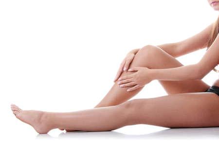 cramp: Woman holding on leg. Isolated on white