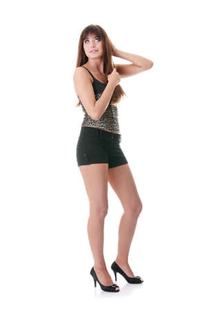 Young beautiful woman wearing shorts posing isolated on a white background Stock Photo - 8956562