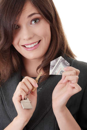 Happy young businesswoman (real estate agent) with keys  photo