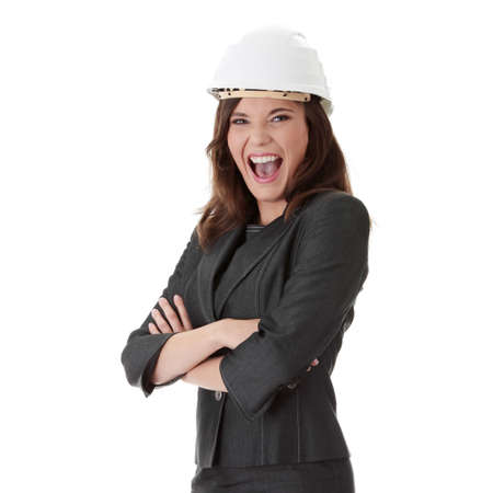 Portrait of confident female worker in white helmet photo