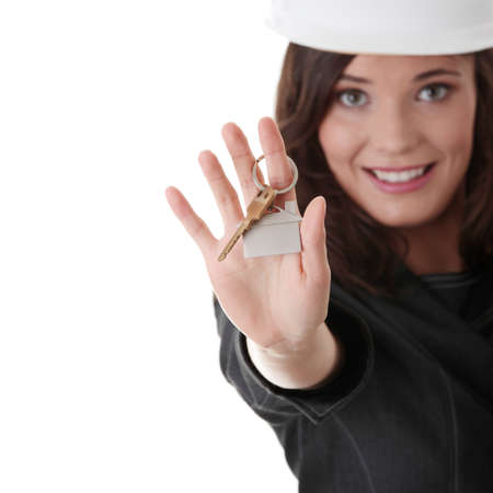 doorkey: Young businesswoman (real estate agent) with keys  Stock Photo