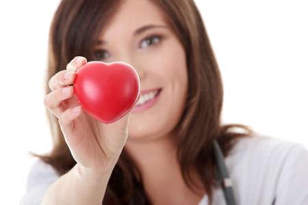 Giovane medico femmina con il cuore in mano.  Isolated on white Archivio Fotografico - 8958780