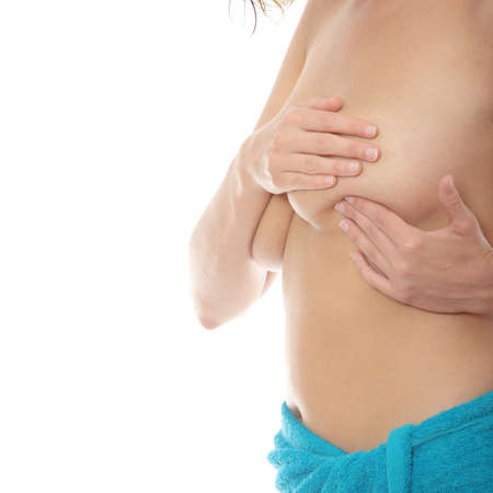 Young Caucasian adult woman examining her breast for lumps or signs of breast cancer Stock Photo - 9018368