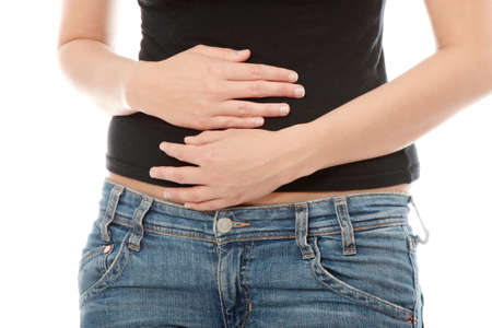 Woman with stomach issues isolated on white background photo
