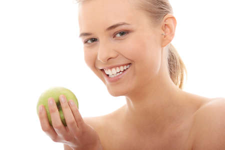 Beautiful girl eating green apple isolated on white background  photo