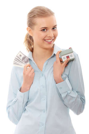 Young beautiful business woman with house model and dollars in hands, isolated on white background photo
