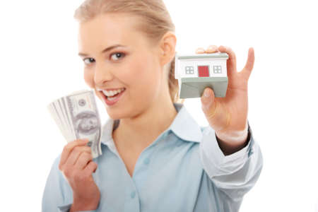 Portrait of beauty woman with money and toy house in hands, isolated on white photo