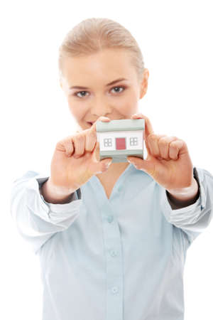 Young businesswoman holding house model, isolated on white background photo